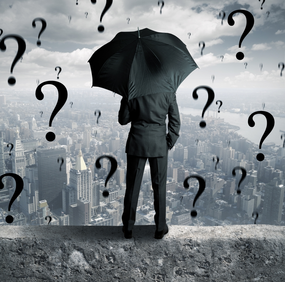 question marks raining from the sky on business man